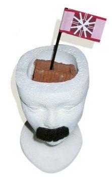 unha cabeza con bigote e un ladrillo conquistado